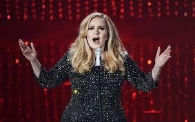 Певица Адель угрожала своей поклоннице перерезать ей горло (ФОТО)